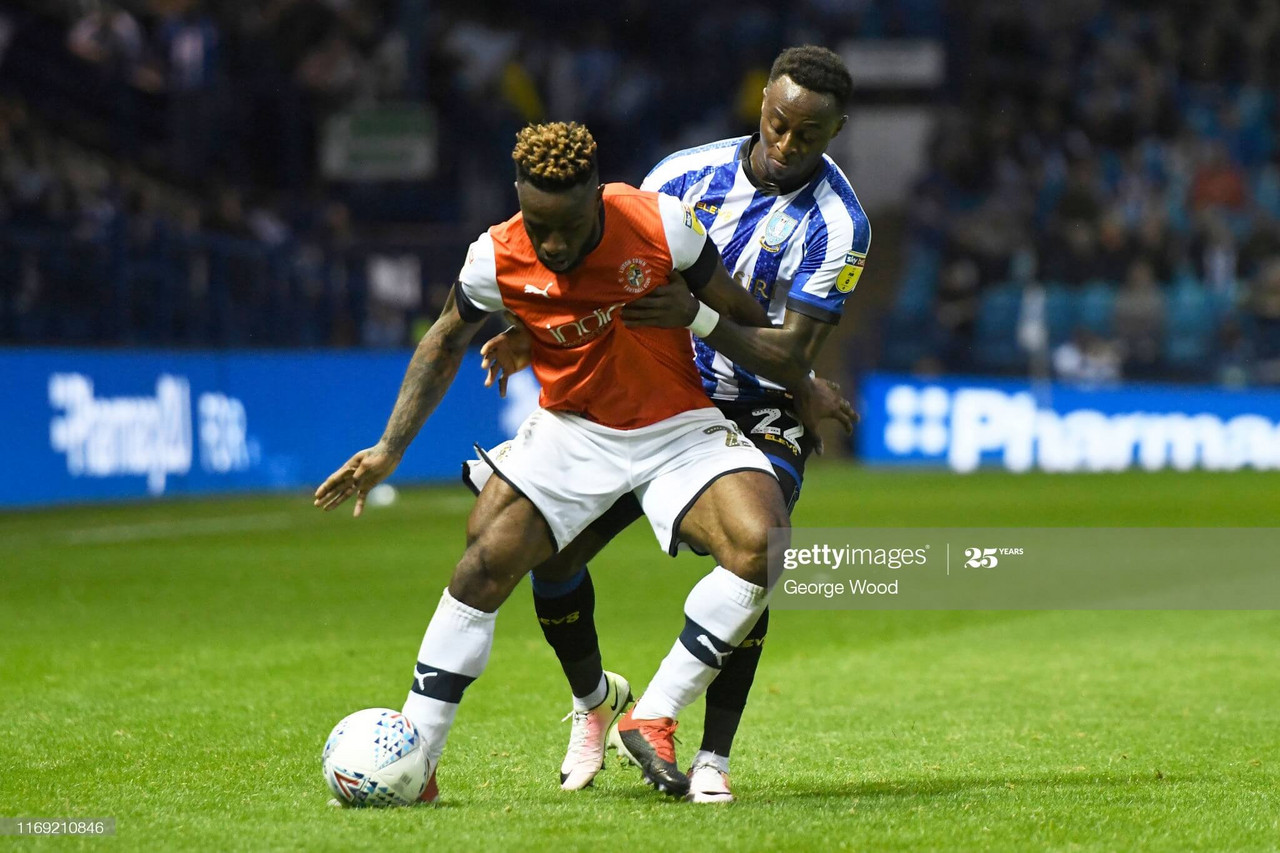 Moses Odubajo battles for the ball with Kazenga LuaLua when the sides met at Hillsborough last season. (Photo by George Wood/Getty Images)<br>