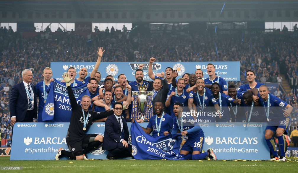 LEICESTER, ENGLAND - MAY 07: Leicester City players celebrate the season champions with the Premier League Trophy after the Barclays Premier League match between Leicester City and Everton at The King Power Stadium on May 7, 2016 in Leicester, United Kingdom. (Photo by Michael Regan/Getty Images)<br>