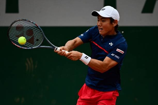 French Open Yoshito Nishioka gets through Felix Auger Aliassime