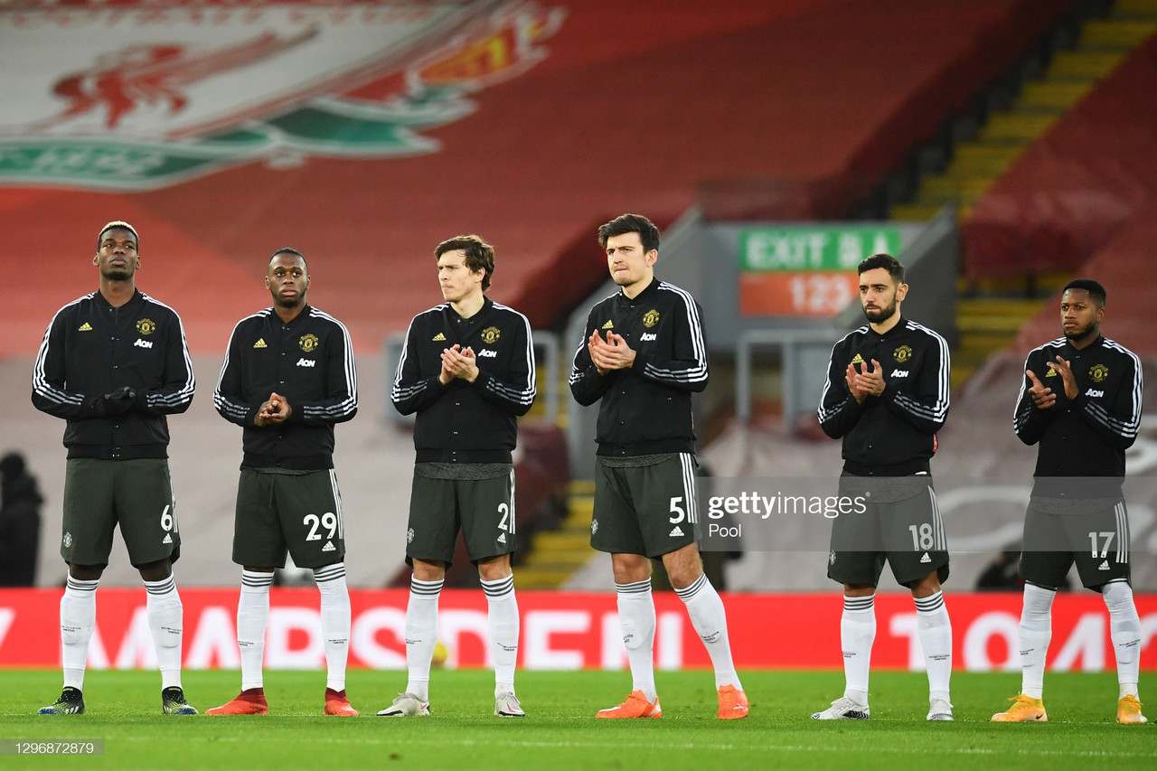 (L - R) Paul Pogba, Aaron Wan-Bissaka, Victor Lindelof, Harry Maguire, Bruno Fernandes and Fred of Manchester United take part in a minute of applause for Singer-songwriter, Gerry Marsden who recently past away ahead of the Premier League match between Liverpool and Manchester United at Anfield on January 17, 2021 in Liverpool, England. Sporting stadiums around England remain under strict restrictions due to the Coronavirus Pandemic as Government social distancing laws prohibit fans inside venues resulting in games being played behind closed doors. (Photo by Paul Ellis - Pool/Getty Images)