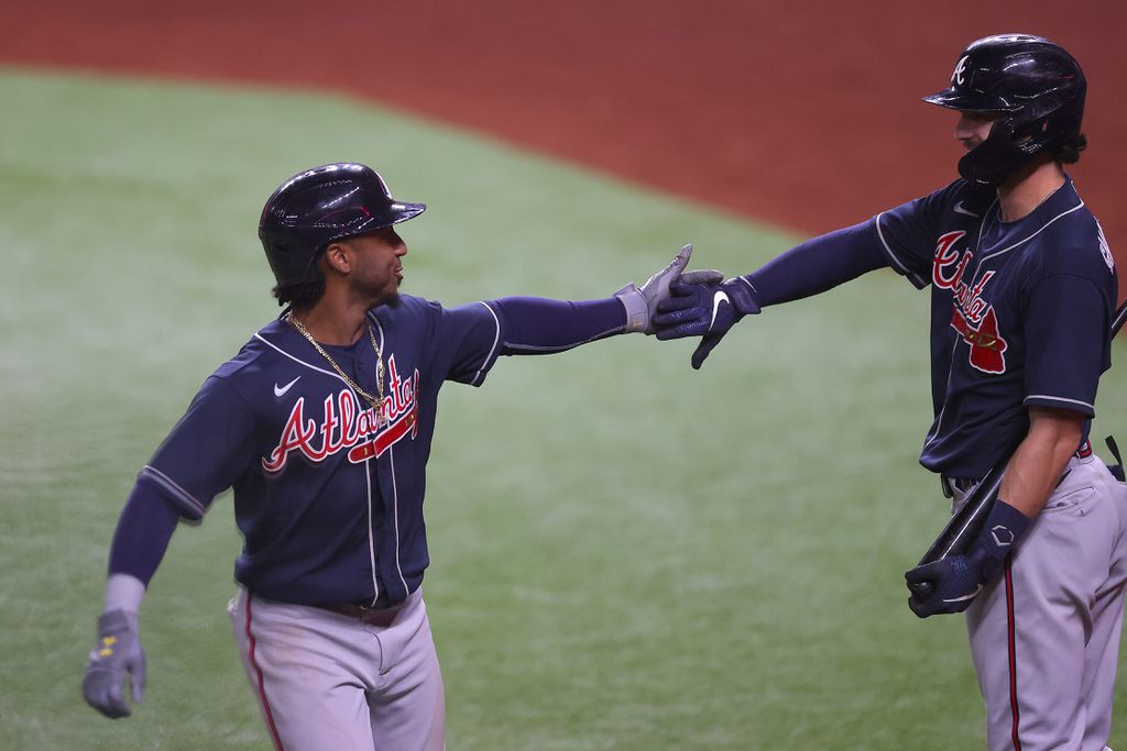 Ozzie Albies (l.) is congratulated by Dansby Swanson (r.) after his ninth inning solo home run/Photo: Ronald Martinez/Getty Images