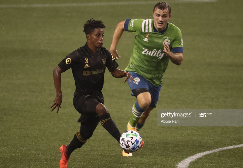 <div>Above: Latif Blessing and Jordan Morris battle for the ball</div>(Photo by Abbie Parr/Getty Images)