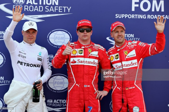 Vettel leads Ferrari party as Raikkonen chafes