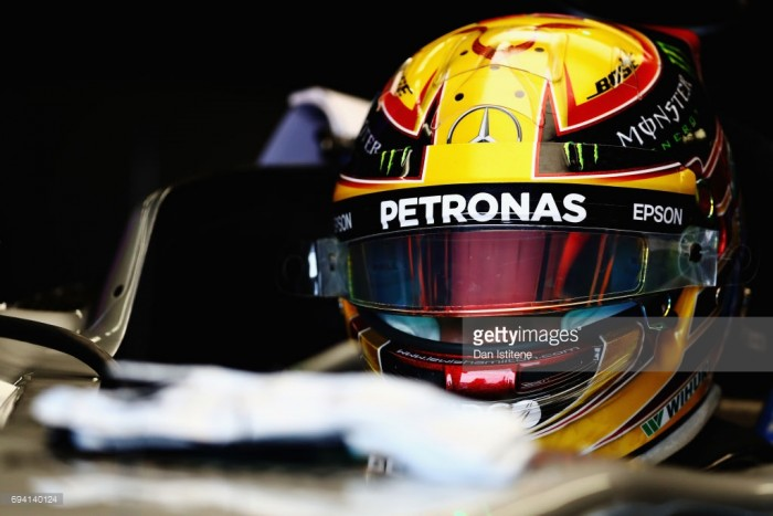 Emotional Hamilton is lost for words with Senna helmet