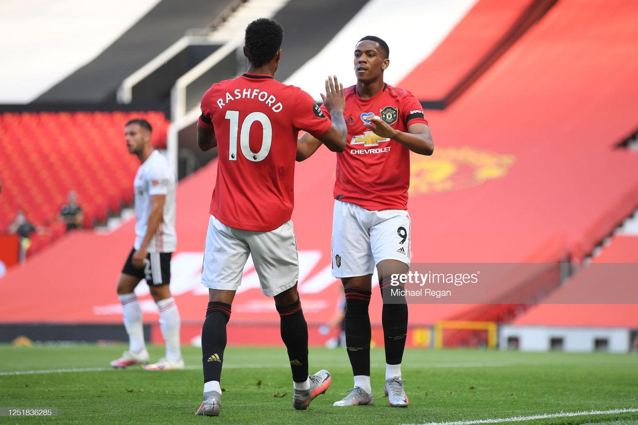 MANCHESTER, ENGLAND - JUNE 24: Anthony Martial of Manchester United celebrates with Marcus Rashford after scoring his team's first goal during the Premier League match between Manchester United and Sheffield United at Old Trafford on June 24, 2020 in Manchester, England. (Photo by Michael Regan/Getty Images)