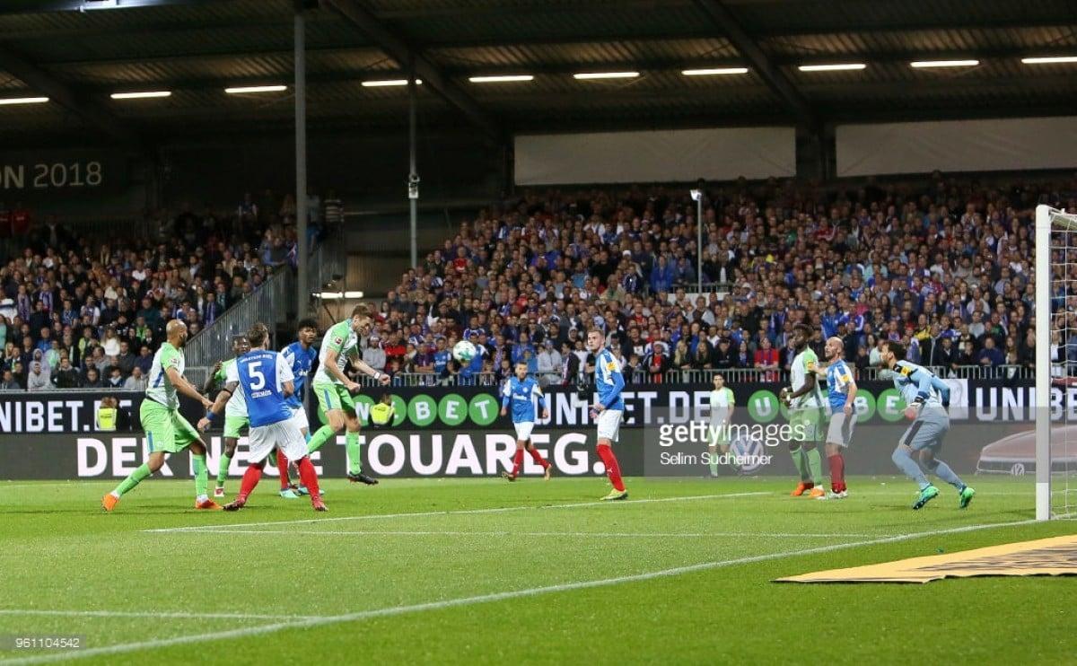 Holstein Kiel (1) 0-1 (4) VfL Wolfsburg: Robin Knoche header confirms the Wolves' survival