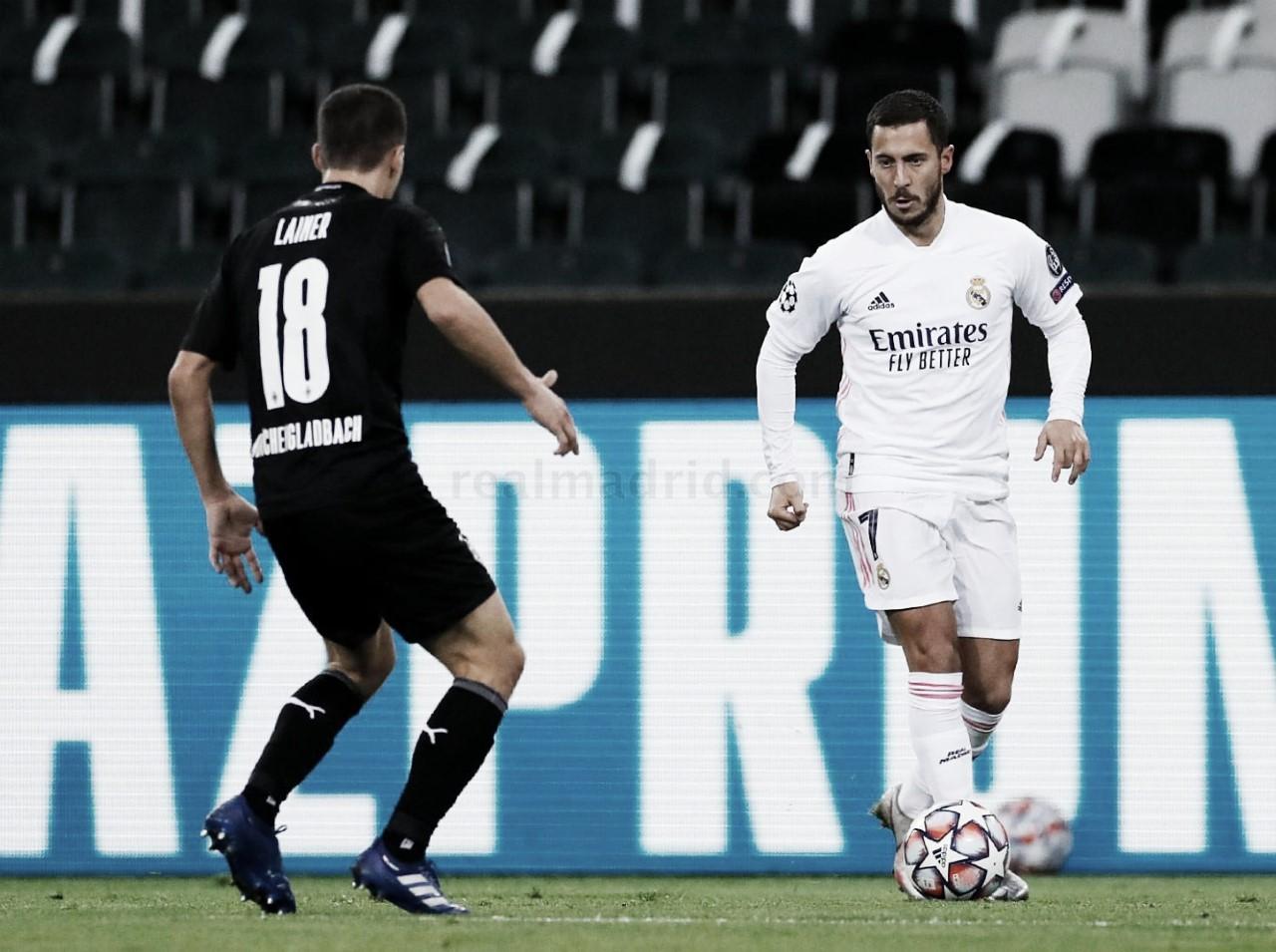Hazard encara a Lainer en el partido ante el Borussia M. Fuente: Real Madrid
