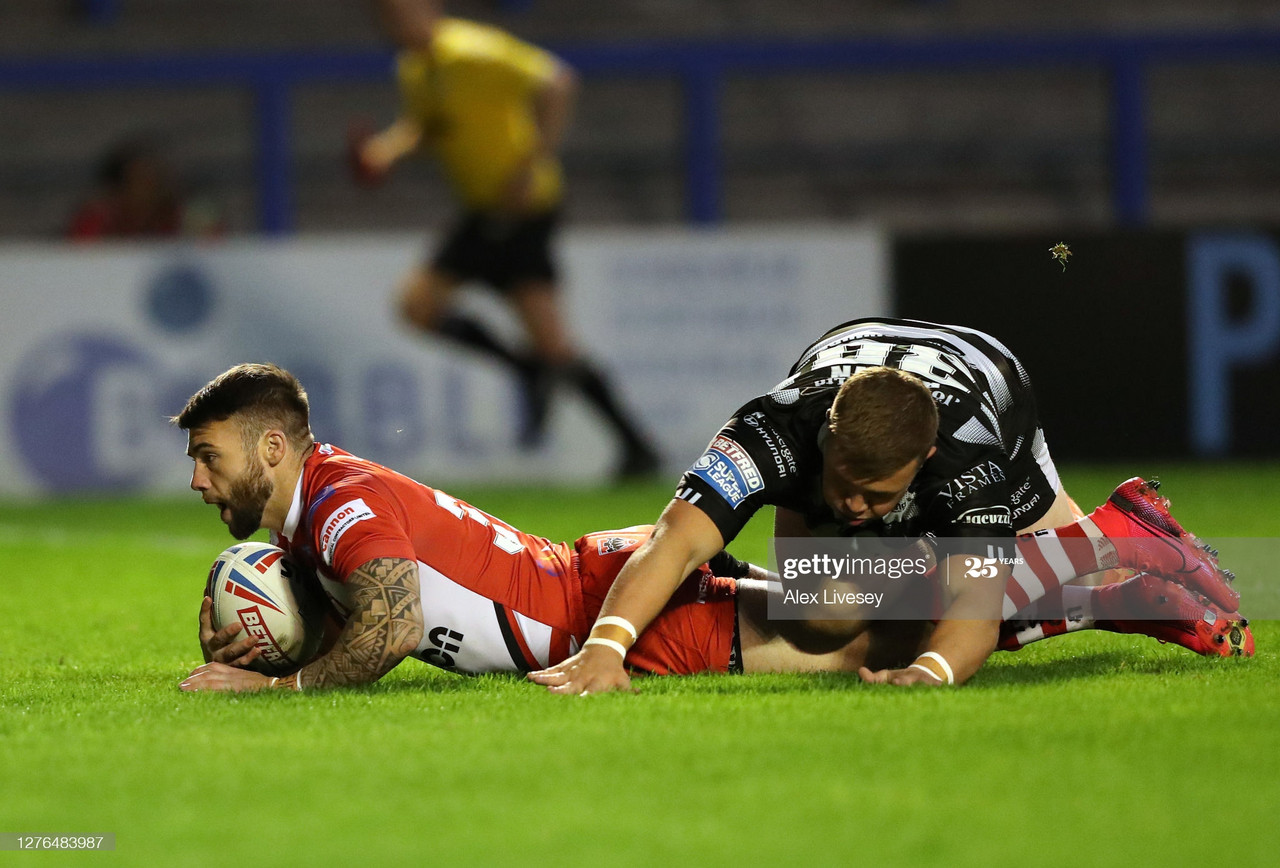 WARRINGTON, ENGLAND - SEPTEMBER 24: Andy Ackers of Salford Red Devils dives over the line to score a try during the Betfred Super League match between Hull FC and Salford Red Devils at The Halliwell Jones Stadium on September 24, 2020 in Warrington, England. Sporting stadiums around the UK remain under strict restrictions due to the Coronavirus Pandemic as Government social distancing laws prohibit fans inside venues resulting in games being played behind closed doors. (Photo by Alex Livesey/Getty Images)