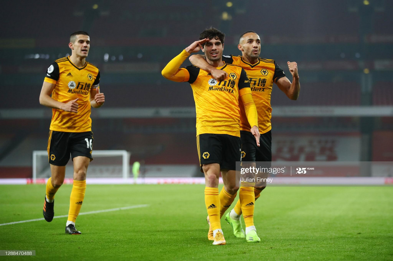 LONDON, ENGLAND - NOVEMBER 29: Pedro Neto of Wolverhampton Wanderers celebrates with teammates Fernando Marcal and Conor Coady after scoring their team's first goal during the Premier League match between Arsenal and Wolverhampton Wanderers at Emirates Stadium on November 29, 2020 in London, England. Sporting stadiums around the UK remain under strict restrictions due to the Coronavirus Pandemic as Government social distancing laws prohibit fans inside venues resulting in games being played behind closed doors. (Photo by Julian Finney/Getty Images)