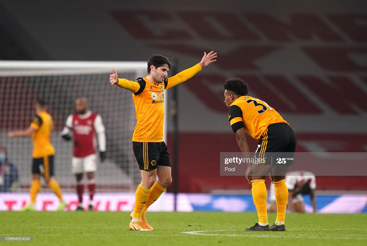 LONDON, ENGLAND - NOVEMBER 29: Pedro Neto of Wolverhampton Wanderers celebrates victory with team mate Adama Traore following the Premier League match between Arsenal and Wolverhampton Wanderers at Emirates Stadium on November 29, 2020 in London, England. Sporting stadiums around the UK remain under strict restrictions due to the Coronavirus Pandemic as Government social distancing laws prohibit fans inside venues resulting in games being played behind closed doors. (Photo by John Walton - Pool/Getty Images)
