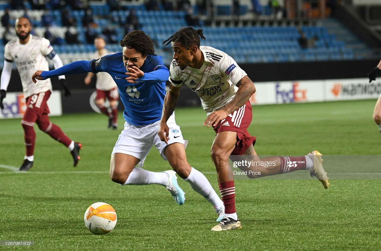 MOLDE, NORWAY - NOVEMBER 26: Reiss Nelson of Arsenal takes on Henry Wingo of Molde during the UEFA Europa League Group B stage match between Molde FK and Arsenal FC at Molde Stadion on November 26, 2020 in Molde, Norway. (Photo by David Price/Arsenal FC via Getty Images)
