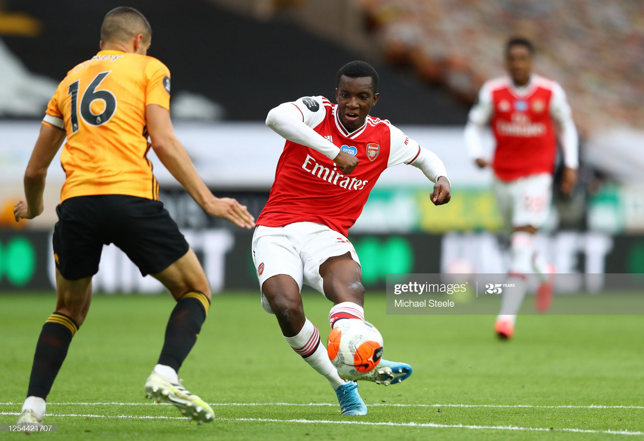 WOLVERHAMPTON, ENGLAND - JULY 04: Eddie Nketiah of Arsenal shoots as Conor Coady of Wolverhampton closes in during the Premier League match between Wolverhampton Wanderers and Arsenal FC at Molineux on July 04, 2020 in Wolverhampton, England. Football Stadiums around Europe remain empty due to the Coronavirus Pandemic as Government social distancing laws prohibit fans inside venues resulting in all fixtures being played behind closed doors. (Photo by Michael Steele/Getty Images)