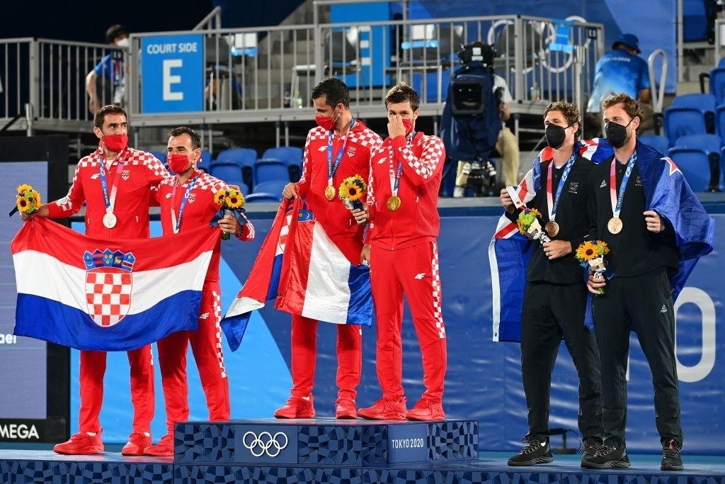 The men's doubles podium. Photo: Vincenzo Pinto