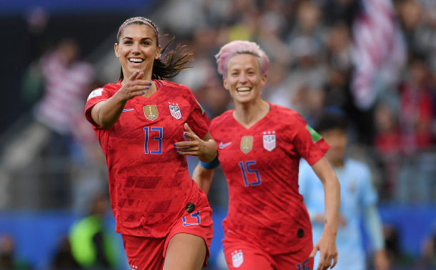 Alex Morgan (13) and Megan Rapinoe (15) celebrate one of their 13 goals against Thailand. (Photo by Alex Caparros - FIFA/FIFA via Getty Images)