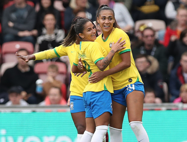 North Carolina Courage midfielder Debinha (left) celebrates her goal against England. (Photo by Ian MacNicol/Getty Images)