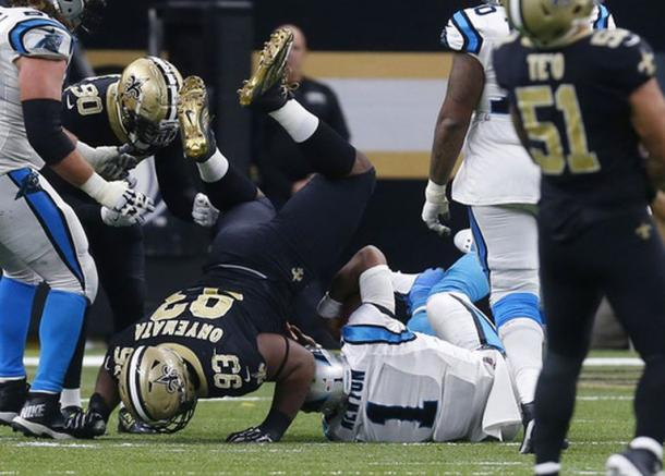 David Onyemata (93) tackles QB Cam Newton (1) in a day where the Saints defense reined supreme (AP Photos)