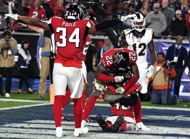 Brian Poole (34) and Keanu Neal (22) react to teammate Deion Jones (44) breaking up a pass intended for Sammy Watkins (12) in their win over the Rams (Pasadena Star-News/SCNG/Keith Birmingham)