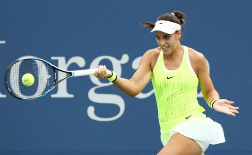 Ana Konjuh hits a forehand to Varvara Lepchenko during their third round match at the U.S. Open/Photo: Elsa/Getty Images