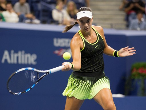 Ana Konjuh hits a forehand return to Agnieszka Radwanska during their fourth round match at the U.S. Open/Don Emmert/AFP