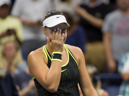 Ana Konjuh reacts after her fourth round victory over Agnieszka Radwanska at the U.S. Open/Photo: Don Emmert/AFP