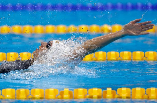 Katinka Hosszu swimming in the 200 meter backstroke in the Olympics/Clive Rose/Getty Images