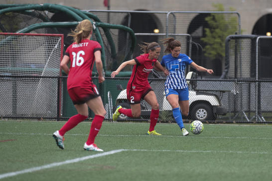 Boston's Stephanie McCaffrey (Right) attempting to cross the ball on Sunday against the Portland Thorns at Jordan Field. Photo provided by The Boston Herald.