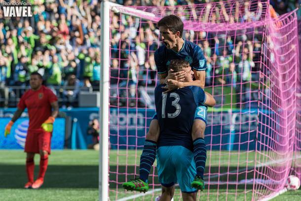 Alvaro Fernandez celebrates with Jordan Morris after his third minute goal against Sporting Kansas City | Source: Brandon Farris - VAVEL USA