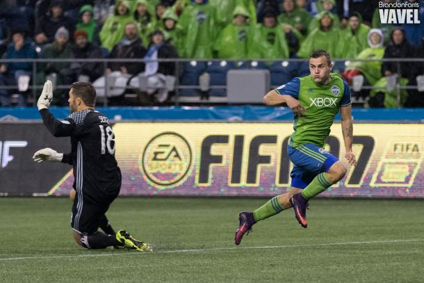 Jordan Morris (left) passes to Nicolas Lodeiro for Seattle's second goal.