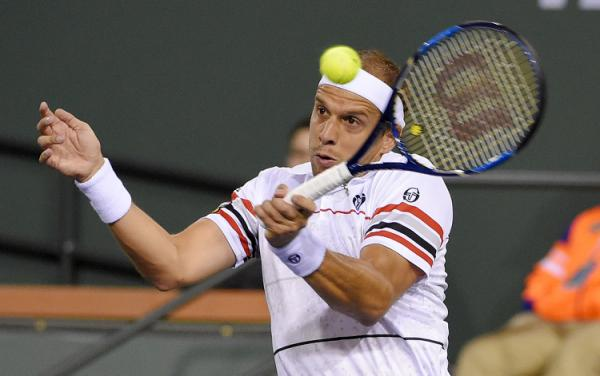 Gilles Muller, of Luxembourg returns a shot to Rafael Nadal, of Spain, at the BNP Paribas Open tennis tournament, Sunday, March 13, 2016, in Indian Wells, Calif. (AP Photo/Mark J. Terrill)