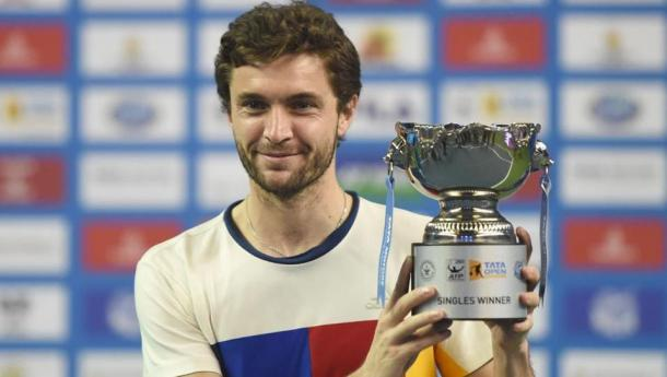 Gilles Simon hoists the trophy in Pune. Photo: AFP