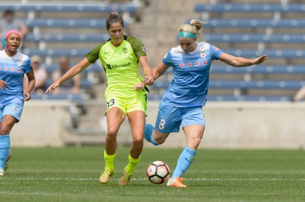 Katie Johnson of Seattle Reign (left) battles with Julie Ertz of the Chicago Red Stars. Source: The Bold