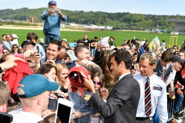 After the ceremony, Federer remained to sign plenty of autographs and to take many selfies. Credit: Keystone