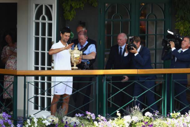Novak Djokovic celebrates his fourth Wimbledon crown (Getty/Michael Steele)