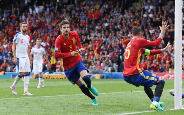 Gerard Pique runs away celebrating after scoring the winner on Monday (Photo: Getty Images)