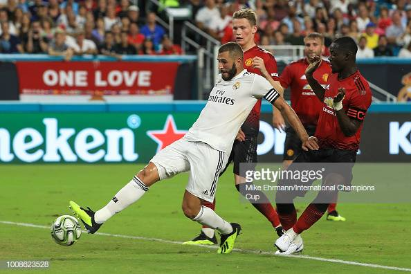 MIAMI, FL - JULY 31: Karim Benzema #9 of Real Madrid scores a goal against Manchester United in the first half of the International Champions Cup at Hard Rock Stadium on July 31, 2018 in Miami, Florida. (Photo by Mike Ehrmann/International Champions Cup/Getty Images)