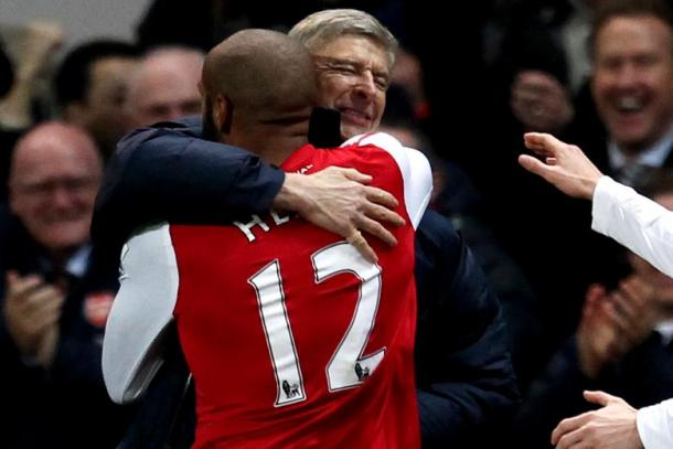 Henry and Wenger embrace following his comeback goal in 2012. | Source: 101greatgoals