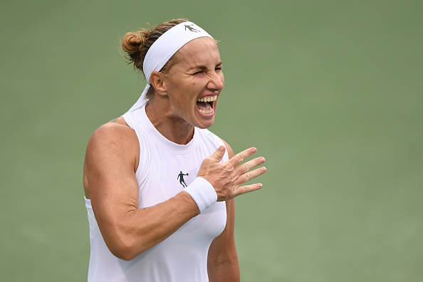 Svetlana Kuznetsova punches her chest after grabbing the huge win, saving four match points against Vekic | Photo: Mitchell Layton/Getty Images Sport