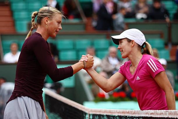 Maria Sharapova and Justine Henin meet after the Belgian's victory in the third round of the 2010 French Open (Getty/Clive Brunskill)