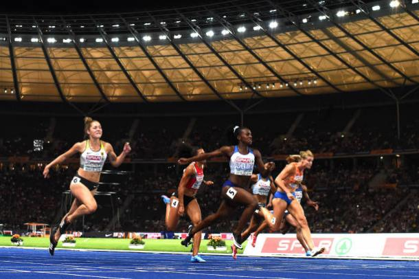 Asher-Smith crosses the line to capture her first International title at 100m (Getty/Matthias Hangst)