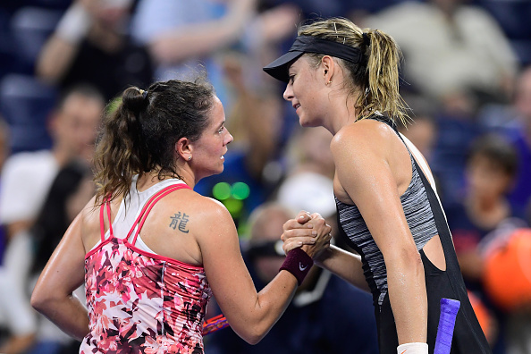 Maria Sharapova (R) and Patty Schnyder (L) shake hands after their first round match at the US Open. Photo: Getty Images / Steven Ryan.