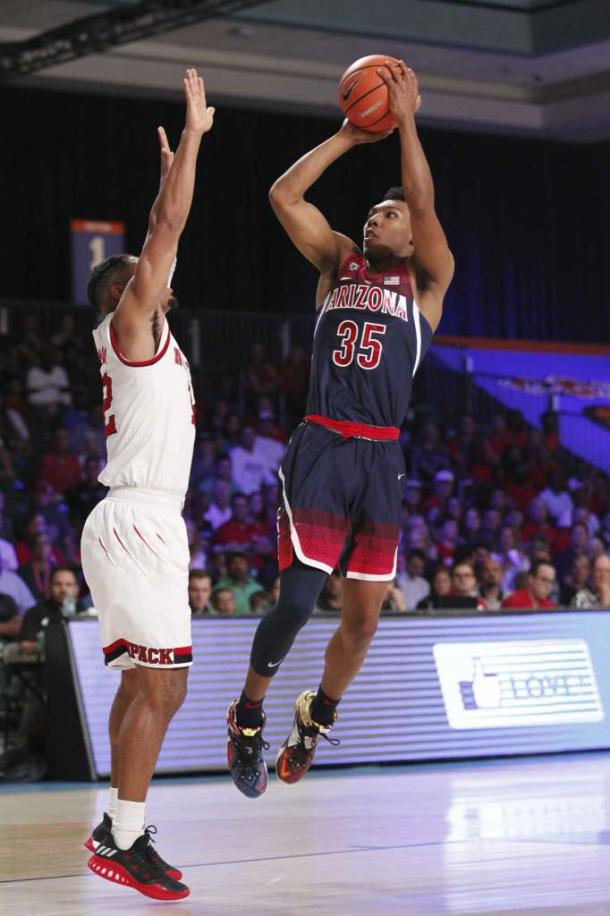 Trier shoots over Freeman in the Bahamas/Photo: Tim Aylen/Associated Press