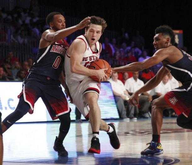 Beverly drives between two Arizona defenders/Photo: Tim Aylen/Associated Press