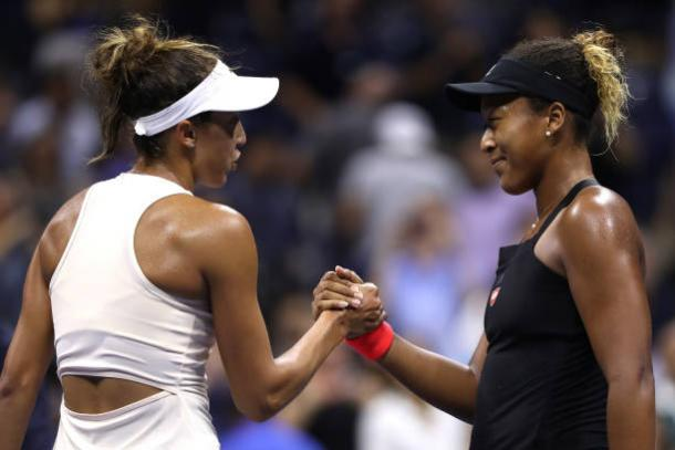 Osaka (right) and Keys (left) embrace each other at the net after the end of their match. (Matthew Stockman/Getty Images Sport)