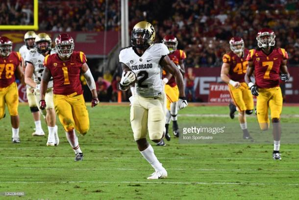 Shenault scores against USC at the Coliseum (image source: Brian Rothmuller/Icon Sportswire via Getty Images)