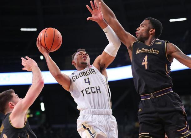 Georgia Tech's Brandon Alston drives to the basket against Northwestern's Vic Law/Photo: Curtis Compton/Atlanta Journal-Constitution via Getty Images