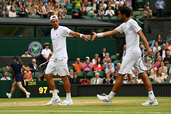 Lukasz Kubot and Marcelo Melo celebrate winning a point (Photo: Shaun Botterill/Getty Images)