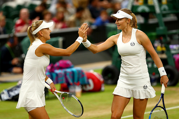 Ekaterina Makarova and Elena Vesnina celebrate winning a point (Photo: Michael Steele/Getty Images)