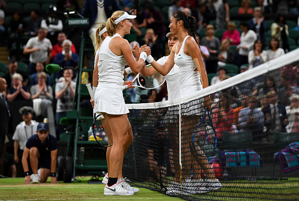 Ekaterina Makarova and Elena Vesnina consolidate Hao-Ching Chan and Monica Niculescu at the net following the final (Photo: Monica Niculescu/Getty Images)