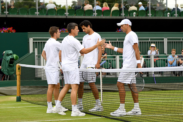 Ken and Neal Skupski congratulate Lukasz Kubot and Marcelo Melo (Photo: David Ramos/Getty Images)
