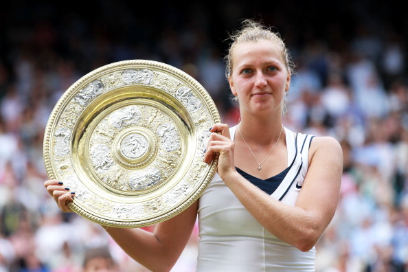 Kvitova poses with her first Grand Slam trophy at the 2011 Wimbledon Champion. Photo credit: Julian Finney/Getty images.